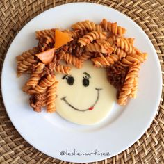The Girl with the Curly Hair | Rotini Pasta with Meat sauce on Provolone Cheeese, draw face with edible markers. Bow made with 2 pieces of bell pepper cut into triangles. By Leslie Martinez