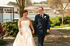The happy couple strolls by the lake after saying 'I do.' #lookoutpoint #weddings #arkansas