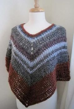 Easy-crochet poncho, free pattern by Kathy North. Takes about 800 yds worsted weight with 'K' hook. . . .ღTrish W ~ http://www.pinterest.com/trishw/ . . .