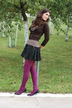 Burgundy tights, dark green tartan skirt and brown pullover
