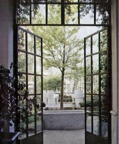 Doors don't get much cooler than this. Check out this awesome set of doors: Pin It Steel windows and doors offer greater strength and design flexibility.
