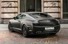 matte black Bentley Continental GT with black wheels