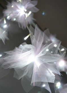 "tulle tied on string lights ""fairy tale"" feel for the head table"
