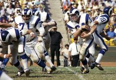 Los Angeles Rams quarterback Roman Gabirel (18) hands off to Les Josephson (34) as he follows the blocking of Joe Scibelli (71) against the San Diego Chargers at The Coliseum.