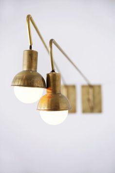 la ostrich farm - brass lights, white brick, and woven elements