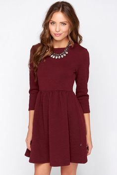 With a cute style that will keep you smiling nonstop, the Diller Burgundy Long Sleeve Dress is perfect for a girl like you! This padded stretch knit dress has a chic quilted pattern, keeping it far from bland. Rounded neckline and three-quarter sleeves amplify the darted bodice, above a flared skirt that gathers at the waist. Hidden side zipper. Unlined. 70% Polyester, 25% Viscose, 5% Spandex. Hand Wash Cold. Imported.
