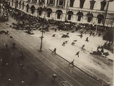 Protesters flee after police fire machine guns into a crowd during the infamous July Days during the early Russian revolution. Petrograd, July 17, 1917.