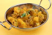 Curry de pommes de terre aux tomates