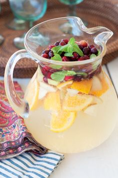 Seasonal White Sangria {serves 2 Bottles Crisp, White Wine 1 Bottle Sparkling Apple Cider 1 Orange, sliced 1 Apple, sliced 1 C. Fresh Cranberries Fresh Mint Leaves Add all of the ingredients; stir and refrigerate until ready to serve. Holiday Drinks, Holiday Treats, Fun Drinks, Yummy Drinks, Holiday Recipes, Yummy Food, Holiday Sangria, Beverages, Fall Sangria