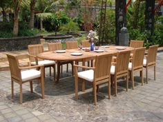 """New 11 Pc Luxurious Grade-A Teak Dining Set - Large 117"""" Oval Table And 10 Stacking Arm Chairs [ Model: LU9] by WholesaleTeak. $1879.99. Table Dimension: 84"""" L (without extension) and 117"""" L (with extension), 40"""" W , 29.5"""" H. Picture shown with more chairs, you will receive only 10 chairs. Stackable chairs for easy storage.. ADD SUNBRELLA FABRIC CUSHIONS BY SEARCHING """"Wholesaleteak Dining Cushion"""" ON AMAZON, CUSTOM MADE FOR THESE STYLE CHAIRS. Stacking Arm Chair Dimensio..."""