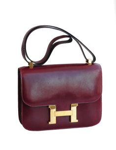 www.resurrectionvintage.com Hermes Burgundy Constance Bag Deep burgundy calfskin leather Constance bag with gold H closure.