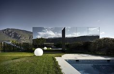 twin mirror houses reflecting the south tyrolean dolomites in Italy