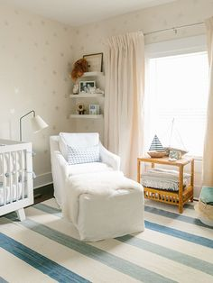 Everyone's favorite room in the house | Image via Glitter Guide of photographer Lucy Cuneo's nursery