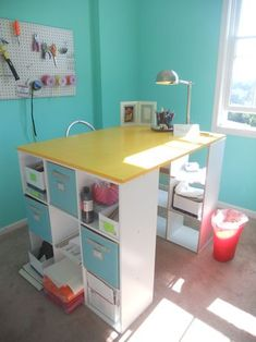 Great craft room organization, with were to buy everything. I think the stand-up desk the made--shown in picture--would make a great teacher desk for me