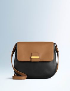 Smooth leather gives this neat little satchel a 'this-old-thing?' vibe, while the rounded cut and colourblocking keep things chic. It's just the right size for daily essentials, without tempting you to pack the kitchen sink.