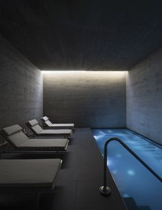 Heated swimming pools grace the spa, a series of enclosed rooms, at the Casino and Hotel Ovalle in Chile by : Felipe Díaz Contardo. Indoor Swimming Pools, Swimming Pool Designs, Spa Design, House Design, Casa Retro, Basement Pool, Dream Pools, Interior Design Magazine, Bathroom Spa