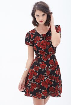 With a structured bodice and a full, flowy A-line skirt, this pretty tailored tea dress is the perfect meeting of effortlessness and polish. Delicate details like the punchy large-scale rose print and puffed short sleeves keep things sweet, and the raised weave adds an element of tangible texture.