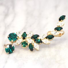ear cuff earrings, Emerald ear cuff earrings, Emerald Swarovski ear climber earrings, Emerald Swarovski Earrings, rocker bride jewelry These handmade Ear cuff Swarovski Earrings, 24 k plated over brass are designed to make an impact set with Emerald and white Crystal An elegant way to finish day or evening looks sweep your hair to the side to showcase.   IF YOU WANT THE BEST CHOSE THE ORIGINAL Arrives in our signature Petite Delights by Ilona Rubin® Box. Sent By Registered Insured mail…