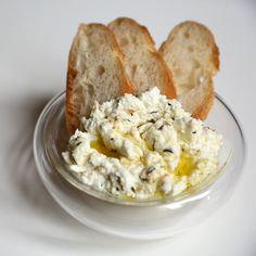 Try this baked goat cheese. Quite possibly the world's simplest dish, baked goat cheese is just that, cheese that's cooked in an oven-safe dish. Serve it with fresh baguette, crostini, or your favorite crackers. Vegetarian Appetizers, Cheese Appetizers, Yummy Appetizers, Appetizer Recipes, Appetizer Dips, Baked Goat Cheese, Goat Cheese Recipes, Cheesy Recipes, Mezze