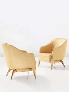 GIO PONTI, a pair of important armchairs, model no. 593, circa 1950.Fabric, oak and brass.Produced by Cassina, Italy. / Phillips