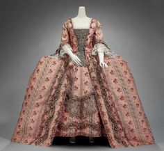 1770, France - Woman's formal dress - Silk and metallic thread, trimmed with metallic lace and silk flowers