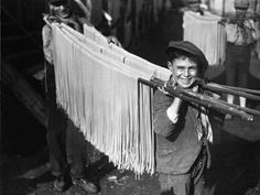 Boys carrying spaghetti in Naples, 1929.