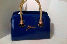 Cobalt blue guess bag with gold detailing