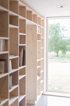 country-home-clean-lines-features-hallway-bookshelves-10-bookshelves.jpg
