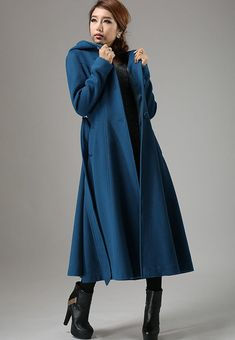 A chic addition to any wardrobe, this blue wool swing coat features a single breasted design with a fit and flare silhouette , finished with a warm hood, and a self tie belt, this cozy coat loos great layered over dress for a stylish ensemble.   DETAIL * Wool blend fabric, and Polyester Lining * hooded neck * Long sleeves * button fastening through the front * tie belt waist * seam detailing * Suit for winter * Accept custom size, need 10-12 days custom * Shipping need 12-15 days * length…