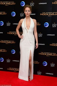 Sexy siren! Jennifer later showed off her racy side in plunging white dress at the Hunger ...