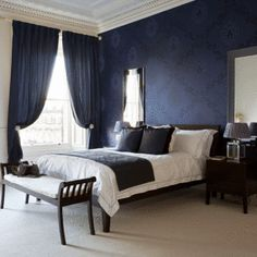 Dark Blue Accent Wall Bedroom navy walls, beige carpet - with white curtains & pops of other