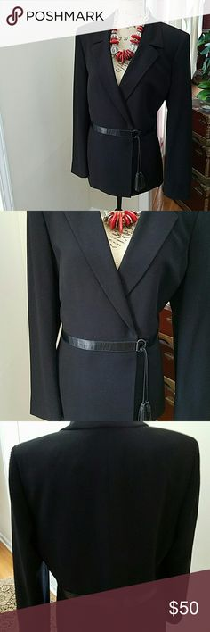 VINTAGE LE SUIT FAUX LEATHER TRIMMED BLAZER This is a timeless Le Suit Blazer.  The waist has a faux leather trimmed side tassel belt. Add skinny faux leather leggings and some stilettos or boots for a casual look. Dress it up with dress  pants or skirt for a more professional look! It does have shoulder pads which I hear are coming back. Le Suit Jackets & Coats Blazers