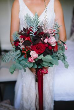 Romantic ruby red and burgundy bouquet with trailing satin ribbon for vintage wedding | Lucinda May Photography