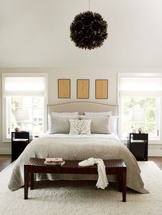 A sophisticated chandelier makes this bedroom one-of-a-kind. More neutral decorating ideas: http://www.bhg.com/rooms/bedroom/color-scheme/neutral-bedroom-colors/#page=7