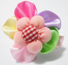 Checkered Rose Baby Hair Clip Multi Colour. 4cm (L) by 4cm (W). Ideal for children from 1 1/2 year old onwards. 1 for $1.50. Like us at https://www.facebook.com/pages/ChucklingBaby/675475065907287.