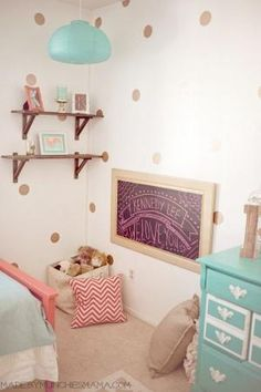 Vintage Mint and Coral Nursery with reclaimed wood décor Reveal.  Glitter vinyl polka dot wall decals and reading nook.  Shelves from ikea stained a distressed. by janet