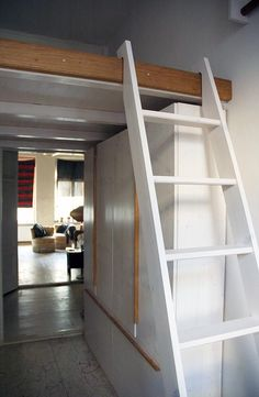 The loft bed and built-in wardrobe are made of spruce wood and white lasi Bunk Bed Ladder, Stair Ladder, Loft Bunk Beds, Loft Bedrooms, New Swedish Design, Home Design, Built In Cupboards, Loft Stairs, Sleeping Loft