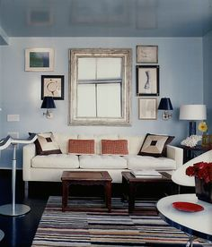 Light blue living room, with a few red accents