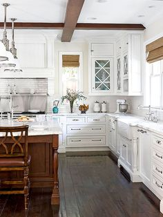 Love the mix of warm woods and the bright whites in the kitchen