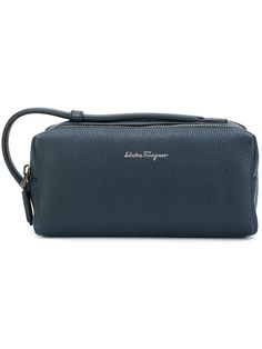 SALVATORE FERRAGAMO  'Lavagna' wash bag $792   Description If it's Italian style with impeccable attention to tailoring you're after, you can't do better than Salvatore Ferragamo. The Lavagna wash bag is presented here in pebbled blue calf leather, taking a rectangular silhouette with a top zip fastening, a leather hand strap and a spacious lined interior, with a front and back compartment and an internal zipped pocket. Designer colour: lavagna Made in Italy