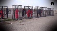 Dalam video terbaru ISIS tersebut, ditunjukkan 21 orang dalam pakaian seragam tahanan berwarna orany... - Dalam video terbaru ISIS tersebut, ditunjukkan 21 orang dalam pakaian seragam tahanan berwarna orany...