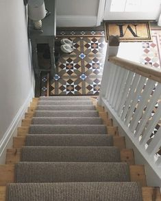 Hallway with original Minton tiles, stripped staircase and carpet runner.