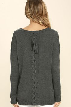 Stay chic even when you're staying in, with the Cozy Time Charcoal Grey Lace-Up Sweater! Super soft knit features a rounded neckline and ribbed cuffs and hem. Sexy lace-up back detail adds a fun touch!