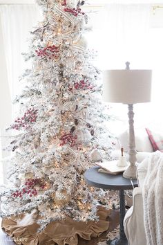 Farmhouse Christmas Family Room with Christmas Tree Decorations in  Red and White with Mercury Glass