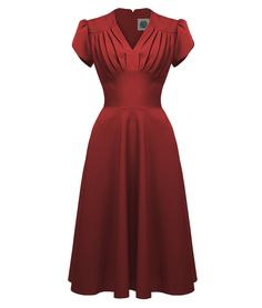 The Pretty Swing Tea Dress in Red.Get down with that big band sound wearing our…