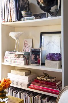 I love this.  a simple bookcase, but organized in such a beautiful, eye pleasing way.