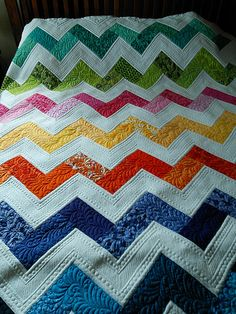 Love the quilting on this chevron quilt!