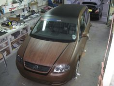 Here's a Touran being spray wrapped, with the wooden effect bonnet and the Black roof, very unique and looks extraordinary. For more vehicle styling visit www.AceCarCare.co.uk or ring us on 01743 466100 with any questions.  #Volkswagen #Touran #Brown #CarWrap #Slammed #Matt #SprayWrap #UltimateDub #CarStyling #CarPeformance