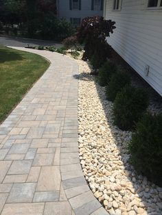 If two paths diverge into one road, why not make it a stylish one! This walkway features Cambridge Pavingstones with ArmorTec.