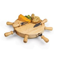 Get the party started with the Mariner! Designed to look like a ship's helm, the Mariner is a great gift for those who love boating. Four cheese tools are secured in magnetic slots evenly spaced on the side of the board, their wooden handles resembling those of a ship's helm.